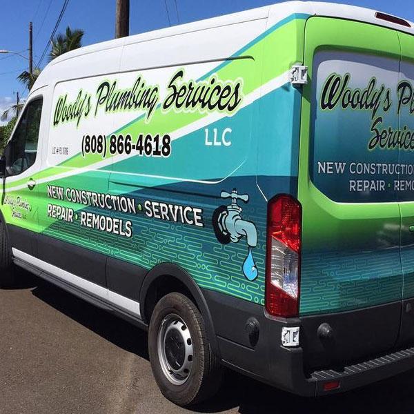 woody's plumbing service car wrap